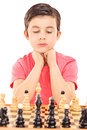Boy playing chess isolated on white background Royalty Free Stock Photos