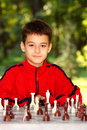 Boy playing chess outdoor Royalty Free Stock Photography