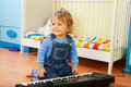 Boy playing a composer Royalty Free Stock Photo