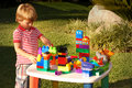 Boy playing with construction blocks Royalty Free Stock Photo