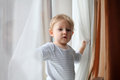 Boy playing with curtains Royalty Free Stock Photo