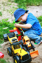 Boy playing with digger Royalty Free Stock Image