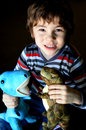 Boy Playing With Dinosaurs