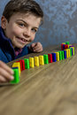 Boy playing with domino Royalty Free Stock Photo