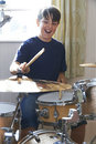 Boy Playing Drum Kit At Home Royalty Free Stock Photo