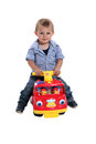 Boy playing on fire engine little a toy Stock Photo