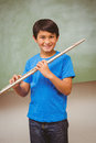Boy playing flute in classroom portrait of cute little Stock Photo