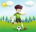 A boy playing football in the hill illustration of Royalty Free Stock Photography