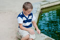 Boy playing by the fountain in a park Royalty Free Stock Photography