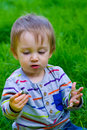 Boy playing in grass a one year old toddler plays the his backyard while waving and looking cute and smiling Royalty Free Stock Photography