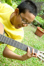 Boy playing guitar Royalty Free Stock Photo