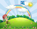 A boy playing with his kite at the hilltop with a rainbow illustration of Stock Images