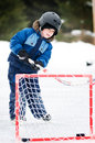 Boy playing hockey Stock Image