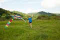 Boy playing with kite happy in field multicolor Stock Image