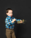 Boy playing with a model airplane little Stock Photography