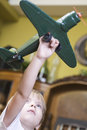 Boy playing with model airplane little blond in home Stock Photos