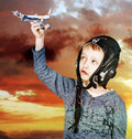 Boy playing with a model airplane at sunset happy kid toy Stock Images