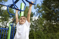 Boy playing on monkey bars Stock Photos