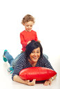 Boy playing with mother toddler riding his and together home Stock Images