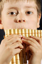 Boy playing panflute Royalty Free Stock Photo