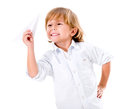 Boy playing with a paper plane happy isolated over white background Stock Images