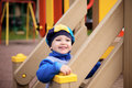 Boy playing on playground little toy hill at Royalty Free Stock Photography