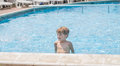 Boy playing in a pool Royalty Free Stock Photo