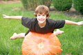Boy Playing on Pumpkin Stock Photo