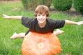 Boy Playing on Pumpkin Stock Photo