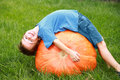 Boy Playing on Pumpkin Stock Images