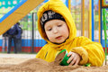A boy playing with sand Royalty Free Stock Images