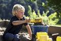 Boy playing in sandbox Royalty Free Stock Photography