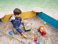 Boy playing in sandbox Royalty Free Stock Photo