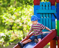 Boy  playing on slide Stock Photography