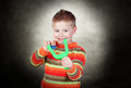 Boy playing with slingshot portrait of a happy indoor Stock Photo