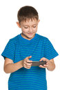Boy playing smartphone white background Stock Images