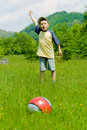 Boy playing soccer Stock Photography