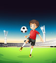 A boy playing soccer alone illustration of Stock Photography