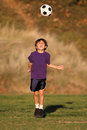 Boy playing with soccer ball in Fall Stock Image