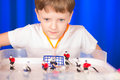 Boy playing table hockey Royalty Free Stock Photo