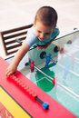 Boy playing table soccer Royalty Free Stock Image