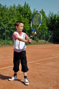 Boy playing tennis Stock Photo