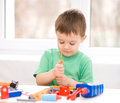 Boy is playing with tools cute little Stock Images