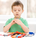 Boy is playing with tools cute little Royalty Free Stock Photos