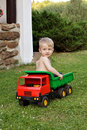 Boy playing with toy car sitting in a truck Stock Images