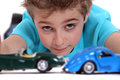 Boy playing with toy cars little Stock Photos