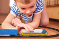 Boy playing with toy railroad Royalty Free Stock Image