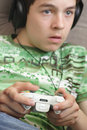 Boy playing video game Royalty Free Stock Photo