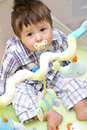 Boy in playpen Stock Image