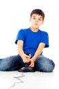 Boy plays on the joystick